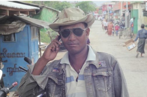 cool looking man from Kalaw, myanmar on the phone wearing sunglasses