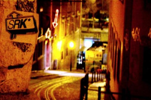 studio rarekind sticker on the street at night in lisbon, portugal